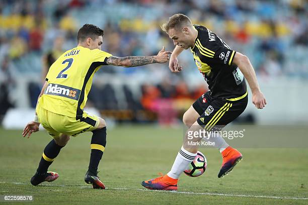 Storm Roux of the Mariners defends against Hamish Watson of the Phoenix during the round six ALeague match between the Central Coast Mariners and the...