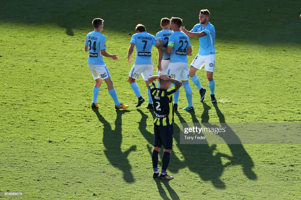 Storm Roux of the Mariners looks dejected as City players celebrate a goal during the round 16 A-League match between the Central Coast Mariners and Melbourne City at Central Coast Stadium on January 14, 2018 in Gosford, Australia.