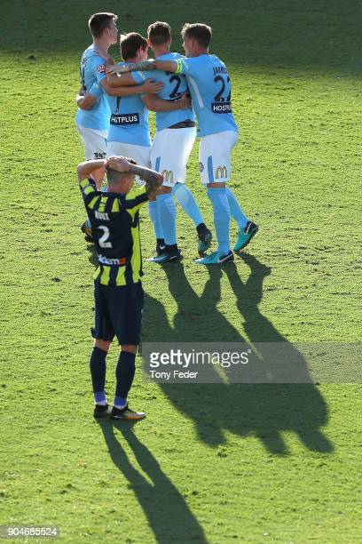 Storm Roux of the Mariners looks dejected as City players celebrate a goal during the round 16 ALeague match between the Central Coast Mariners and...