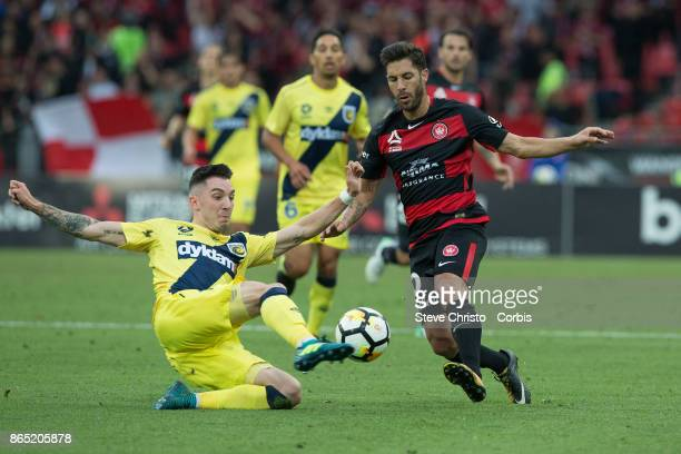 Storm Roux of the Mariners tackles Wanderers Alvaro Cejudo during the round two ALeague match between the Western Sydney Wanderers and the Central...