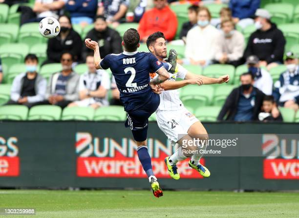 Storm Roux of the Victory and Connor O'Toole of the Jets collide as they compete for the ball during the A-League match between the Melbourne Victory...