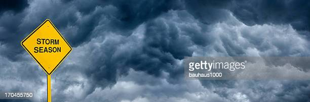 storm season caution sign - storm season tornadoes stock photos and pictures