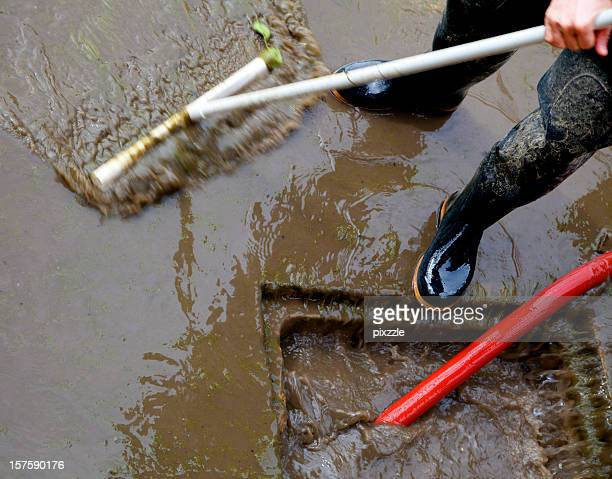storm sewer flood dirty water cleanup - flooding stock photos and pictures