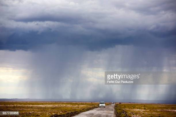 Storm sky and dirt road at Chaxas Lagoon of San Pedro de Atacama, Antofagasta Region, Chile