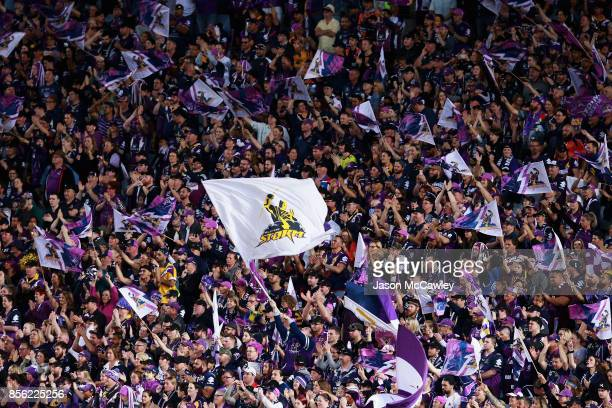 Storm supporters cheer during the 2017 NRL Grand Final match between the Melbourne Storm and the North Queensland Cowboys at ANZ Stadium on October 1...