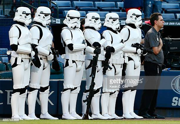 Storm trooper characters from the 501st Legion stand during the National Anthem prior to the game between the Atlanta Braves and the New York Mets at...