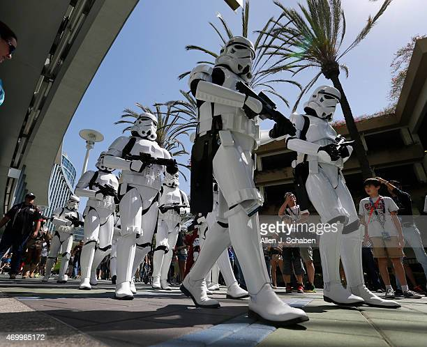 Storm Troopers from Star Wars join a parade of characters from the worldwide 501st Legion costume organization while they make a dramatic entrance...