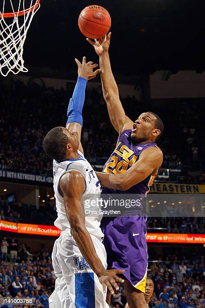 Storm Warren of the LSU Tigers shoots the ball over Terrence Jones of the Kentucky Wildcats during the quarterfinals of the SEC Men's Basketball...