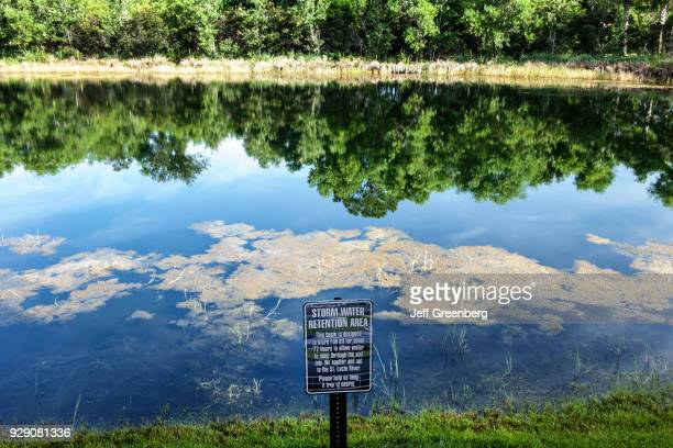 Storm water retention area sign next to a pond at the Courtyard by Marriott in Stuart.