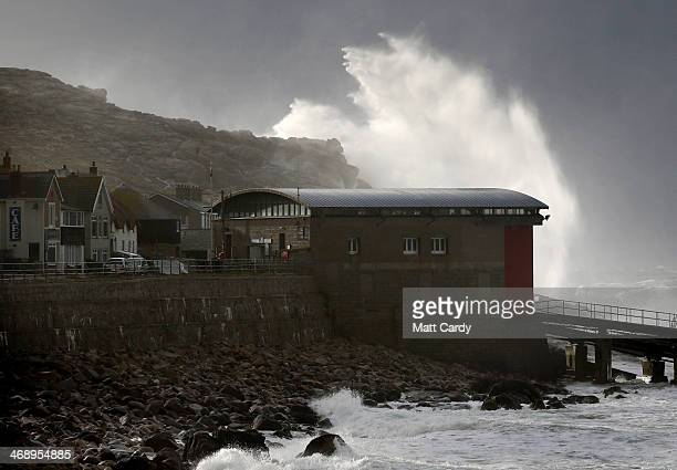 Storm waves crash over cliffs at Sennen Cove near Lands End on February 12 2014 in Cornwall England Parts of the UK are experiencing severe storms...