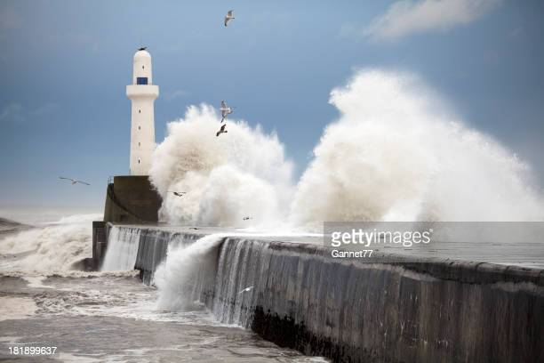 Storm waves striking the Aberdeen harbour breakwater, Scotland