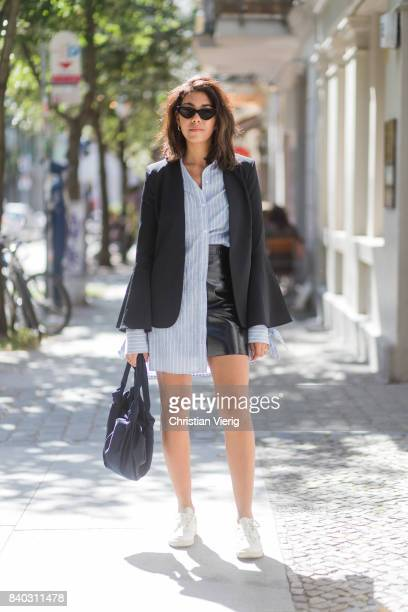 Storm Westphal wearing a black Iris und Ink blazer a blue white striped Edited blouse black other Stories mini skirt Reebok classic sneakers Le Specs...
