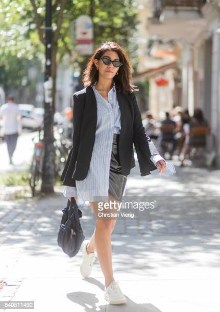Storm Westphal wearing a black Iris und Ink blazer, a blue white striped Edited blouse, black &other Stories mini skirt, Reebok classic sneakers, Le...