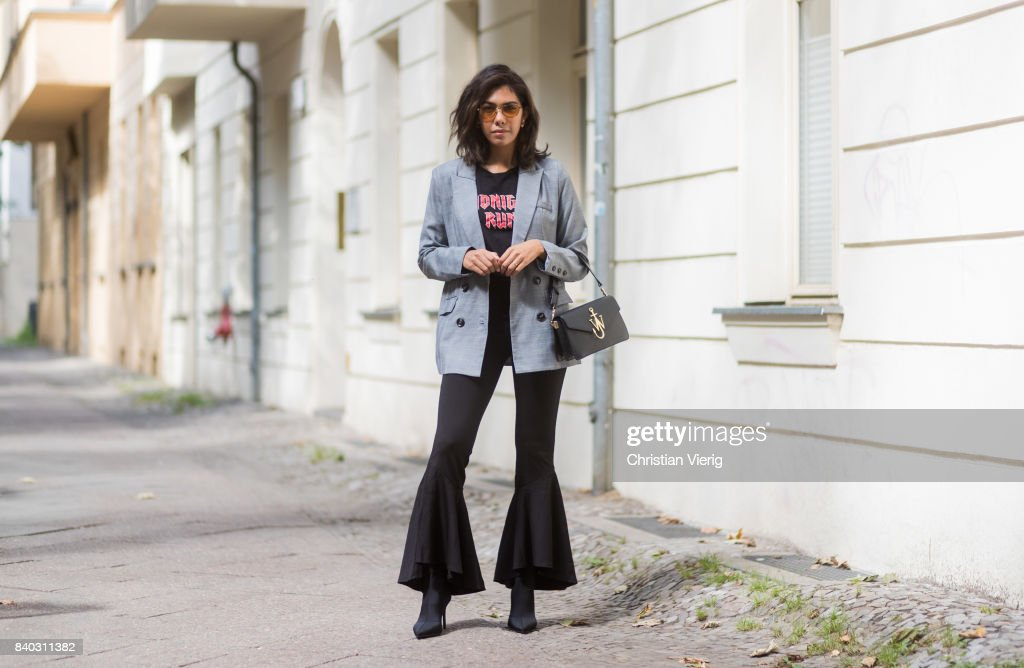 Storm Westphal wearing a black JW Anderson bag, a grey Walter Baker blazer, black flared Walter Baker pants, vogue eyewear x Gigi Hadid sunglasses, black tshirt, Mango boots, Jane Koenig earings on August 28, 2017 in Berlin, Germany.