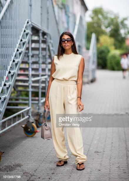 Storm Westphal wearing beige overall is seen outside Stine Goya during the Copenhagen Fashion Week Spring/Summer 2019 on August 8, 2018 in...