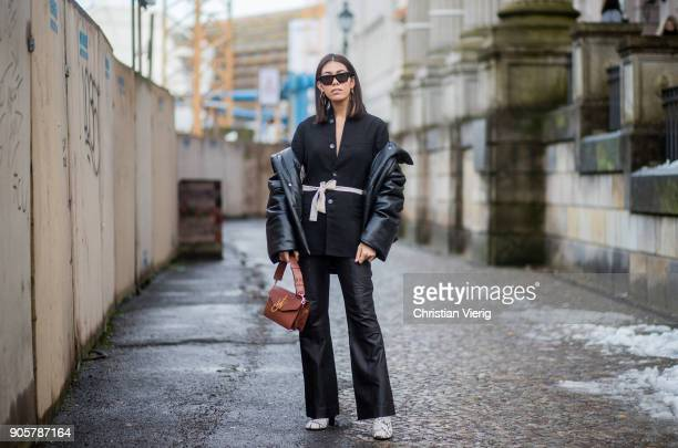 Storm Westphal wearing black jacket Nanushka blazer Bassike pants Irese Ink Jopseph shoes JW Anderson bag Celine sunglasses is seen outside Der...