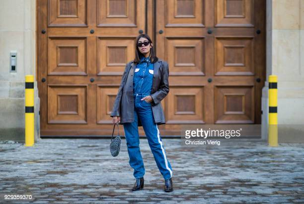 Storm Westphal wearing Calvin Klein denim jacket and jeans Ganni shoes Dior hand bag vintage leather coat Viu sunnies is seen on March 8 2018 in...