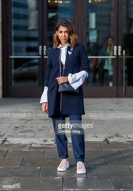 Storm Westphal wearing MaxCo coat blouse Edited Celine trio bag Selected Femme pants Axel Arigato sneaker during the MercedesBenz Fashion Week Berlin...