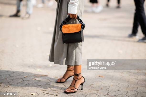Storm Westphal wearing rey skirt, whit blouse, two tone bag is seen outside Holzweiler during the Copenhagen Fashion Week Spring/Summer 2019 on...