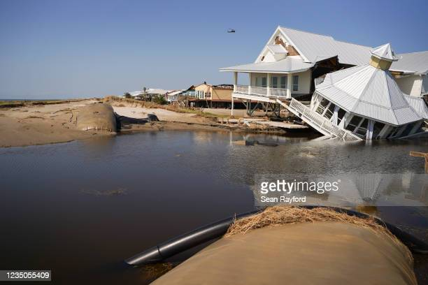 Storm-damaged house at a busted levy on the beach after Hurricane Ida on September 4, 2021 in Grand Isle, Louisiana. Ida made landfall as a Category...
