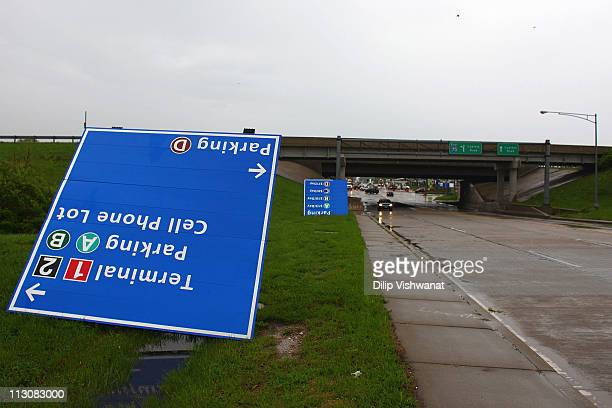 Stormdamaged signs lie on the ground at LambertSt Louis International Airport April 23 2011 in St Louis Missouri The airport is closed today after...