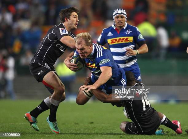 Stormers captain Schalk Burger is tackled by S'bura Sithole of the Sharks during the Super Rugby match between DHL Stormers and Cell C Sharks at DHL...