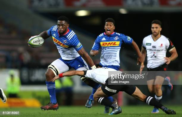 Stormers captain Siya Kolisi attempts to get past Keisuke Uchida of Sunwolves attempted tackle during the Super Rugby match between DHL Stormers and...