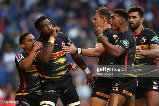 Stormers captain Siya Kolisi celebrates with teammates after scoring the opening try during the Super Rugby match between DHL Stormers and Crusaders...