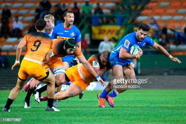 Stormers' Damian De Allende is tackled during the Super Rugby rugby union match between South Africa's Stormers and Argentina's Jaguares at Newlands...