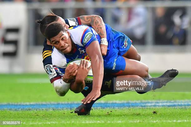 TOPSHOT Stormers' Damian Willemse is tackled by Highlanders' Aaron Smith during the Super Rugby match between New Zealand's Otago Highlanders and...