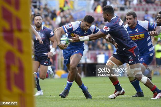 Stormers' Damien de Allende runs to score a try during the Super Rugby rugby union match between South Africa's Stormers and Australia's Rebels on...
