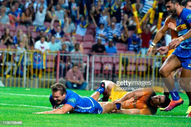 Stormers' Dan du Plessis scores a try during the Super Rugby rugby union match between South Africa's Stormers and Argentina's Jaguares at Newlands...