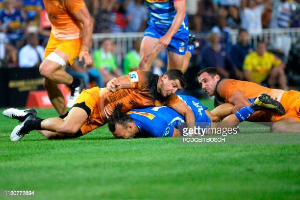 Stormers' Dillyn Leyds is tackled during the Super Rugby rugby union match between South Africa's Stormers and Argentina's Jaguares at Newlands...
