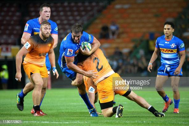 Stormers' Even Etzebeth is tackled during the Super Rugby rugby union match between South Africa's Stormers and Argentina's Jaguares at Newlands...