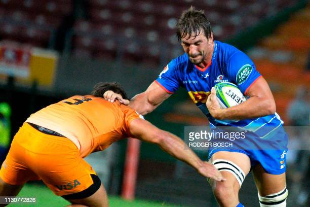 Stormers' Even Etzebeth runs with the ball during the Super Rugby rugby union match between South Africa's Stormers and Argentina's Jaguares at...