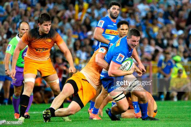 Stormers' JD Schickerling is tackled during the Super Rugby rugby union match between South Africa's Stormers and Argentina's Jaguares at Newlands...