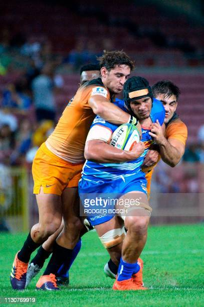 Stormers' Juarno Augustus is tackled during the Super Rugby rugby union match between South Africa's Stormers and Argentina's Jaguares at Newlands...