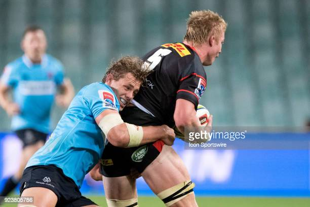 Stormers player PieterSteph du Toit tackled by Waratahs player Ned Hanigan at round 2 of the Super Rugby between The Waratahs and Stormers at Allianz...