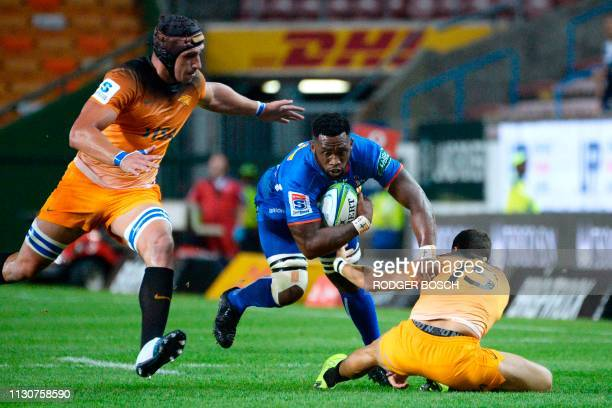 Stormers' Siya Kolisi is tackled during the Super Rugby rugby union match between South Africa's Stormers and Argentina's Jaguares at Newlands...