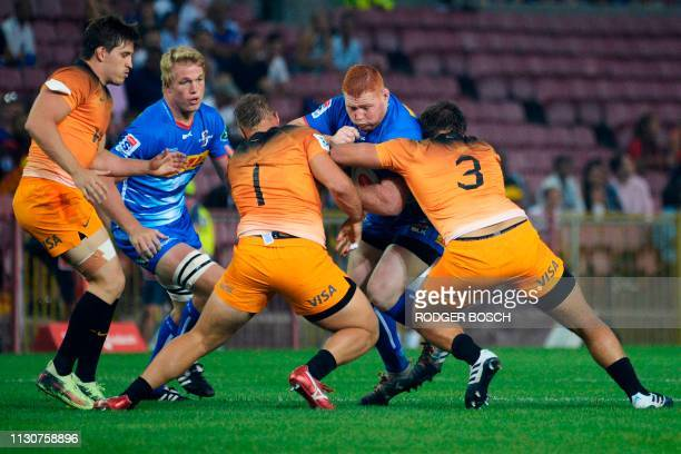 Stormers' Steven Kitsoff tackled during the Super Rugby rugby union match between South Africa's Stormers and Argentina's Jaguares at Newlands...