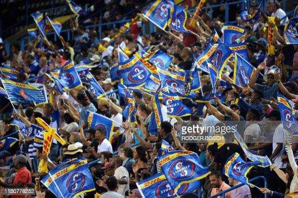 Stormers' supporters cheer during the Super Rugby rugby union match between South Africa's Stormers and Argentina's Jaguares at Newlands Stadium in...