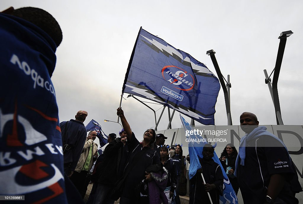 Stormers supporters wave flags as they gather outside Orlando stadium ahead of the Super14 Final match between Bulls and Stormers in Johannesburg, on May 29, 2010.