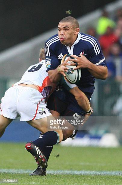 Stormers wing Bryan Habana is tackled during the Super 14 round six match between the Stormers and Cheetahs at Newlands Stadium on March 20 2010 in...