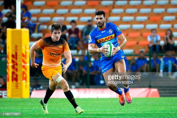 Stormers's Damian De Allende runs with the ball during the Super Rugby rugby union match between South Africa's Stormers and Argentina's Jaguares at...