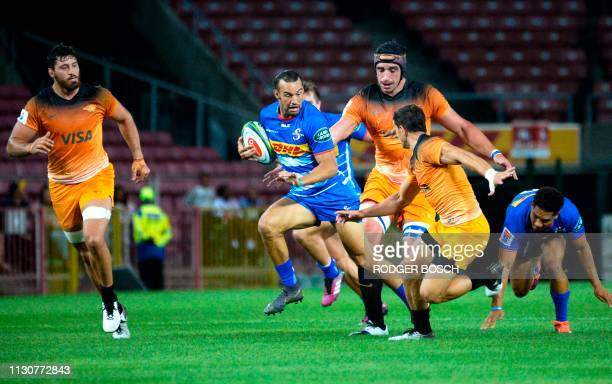 Stormers's Dillyn Leyds runs with the ball during the Super Rugby rugby union match between South Africa's Stormers and Argentina's Jaguares at...