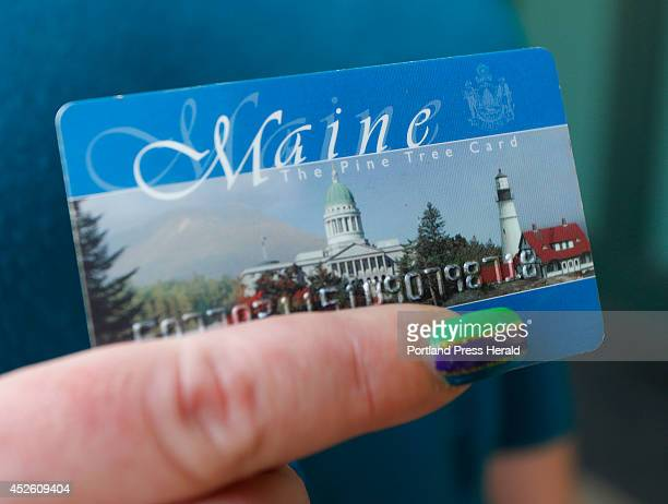 Stormie Whitten holds her Maine EBT card after shopping for groceries at Paul's grocery store Gov Paul LePage announced Wednesday that Maine will no...