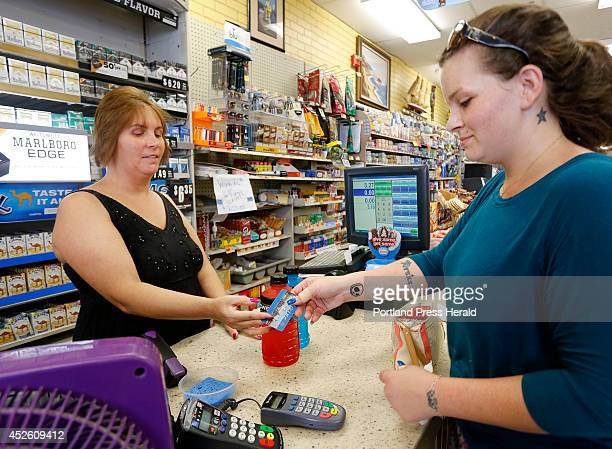 Stormie Whitten uses her Maine EBT card while shopping for groceries at Paul's grocery store Gov Paul LePage announced Wednesday that Maine will no...