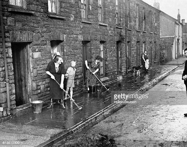 Storms caused heavy flooding in areas of South Wales such as this street at Briton Ferry Houses were flooded road and rail traffic was disrupted and...