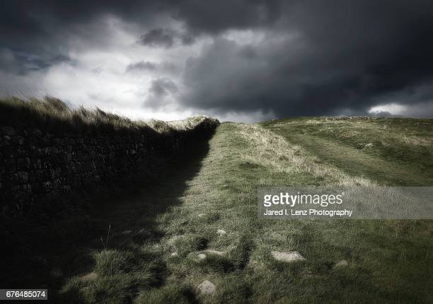 storm's coming over hadrian's wall - roman army stock pictures, royalty-free photos & images