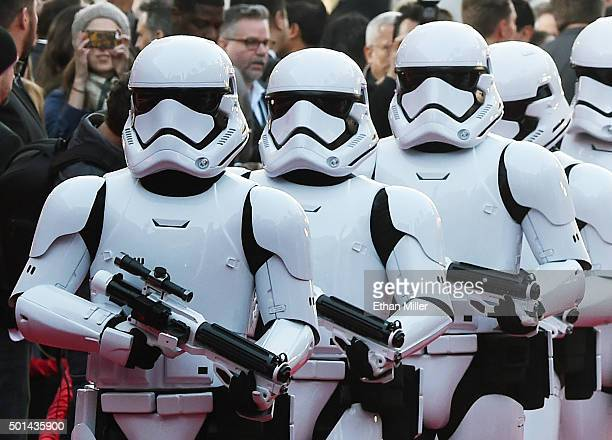 Stormtrooper characters march down the red carpet at the premiere of Walt Disney Pictures and Lucasfilm's Star Wars The Force Awakens at the Dolby...